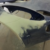 Filler applied ready for rubbing down smooth to shape of bonnet